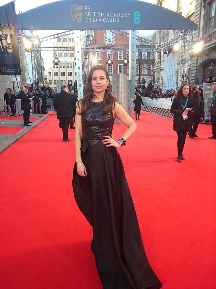 In a Black Tony Ward gown on the BAFTAS Red Carpet in London