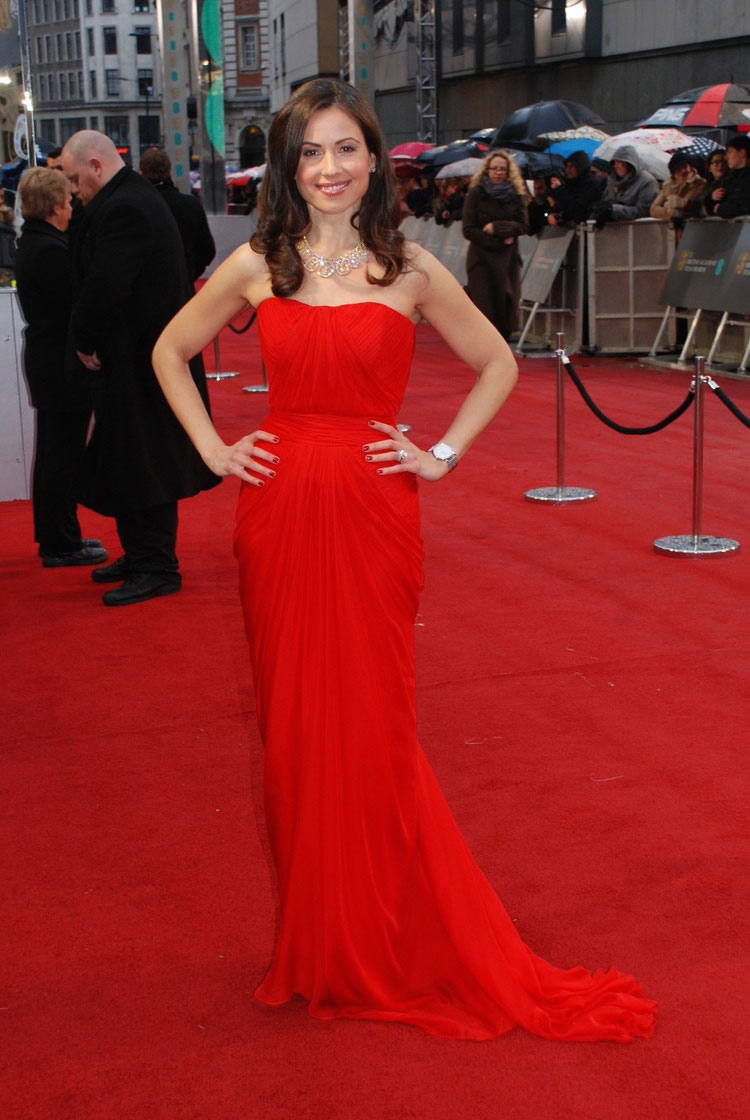 In a Red AIISHA custom made Couture gown at the BAFTA Awards