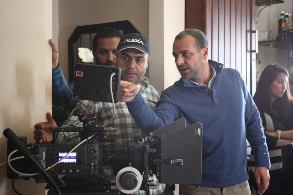 Tamer Mohsen with Asmaa Abulyazid behind the scenes of Haza Almasaa